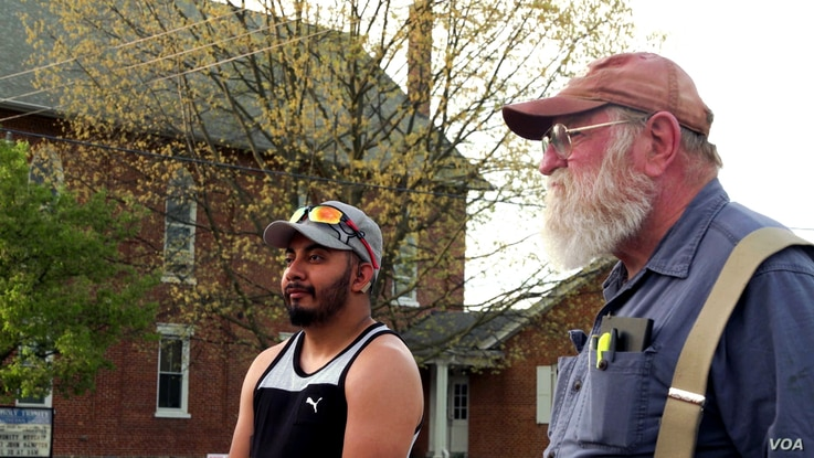 Two York Springs residents wait their turn to order from a taco truck that does business in the town. (M. Kornely/VOA)