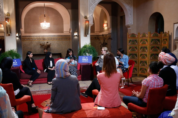 First lady Michelle Obama, rear center, actress and girls' education advocate Meryl Streep, second right, and Indian actress Freida Pinto, left on sofa, participate in a conversation with adolescent girls in Marrakech, Morocco, June 28, 2016.