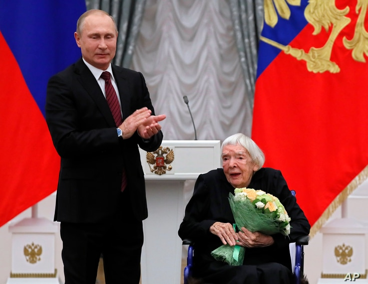 FILE - Russian President Vladimir Putin congratulates the Moscow Helsinki Group Chair and human rights activist Lyudmila Alexeyeva, during a ceremony to present the 2017 State Awards for Outstanding Achievements in Human Rights and and Charity Work i...