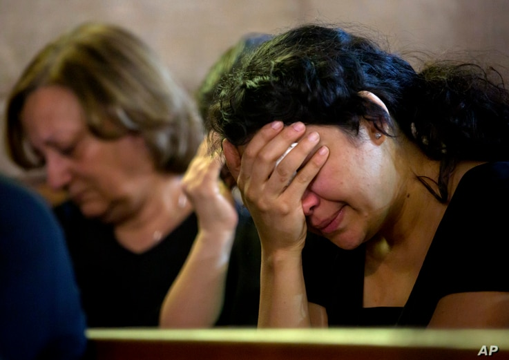 Coptic Christians grieve during prayers for the departed, remembering the victims of EgyptAir flight 804 at Al-Boutrossiya Church, at the main Coptic Cathedral complex, in Cairo, Egypt, May 22, 2016.