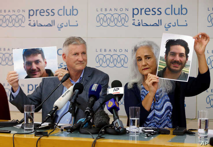 ILE - Marc and Debra Tice, the parents of Austin Tice, who has been missing in Syria since August 2012, hold up photos of him during a new conference, at the Press Club, in Beirut, Lebanon, July 20, 2017. Federal authorities are offering a reward of