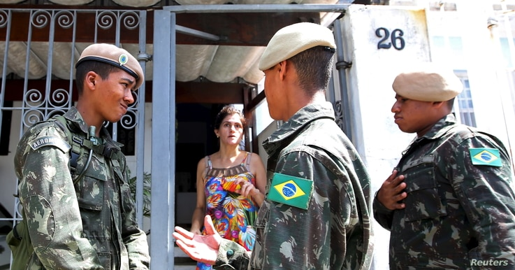 Brazilian soldiers conduct an inspection for the Aedes aegypti mosquito as part of efforts to prevent the spread of the Zika virus, along a street in Sao Paulo, Brazil, Feb. 1, 2016.