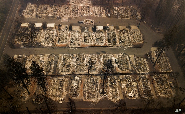 Homes were leveled by the wildfire in Paradise, Calif., Nov. 15, 2018. The California officials said Thursday the wildfire that destroyed the town of Paradise is now 40 percent contained.