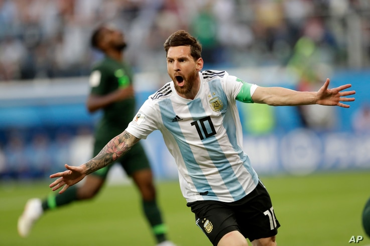 FILE - Argentina captain Lionel Messi celebrates after scoring the opening goal of his team during a match between Argentina and Nigeria, at the 2018 World Cup in St. Petersburg, Russia, June 26, 2018.