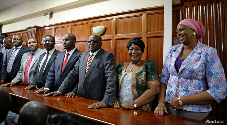 """Kenyan politicians Aisha Jumwa, Florence Mutua, Johnstone Muthama, Junet Mohammed, Timothy Bosire, Ferdinand Waititu, Moses Kuria and Kimani Ngunjiri stand in the dock at the Milimani Law Courts over alleged """"hate speech"""", flagging growing tension in..."""