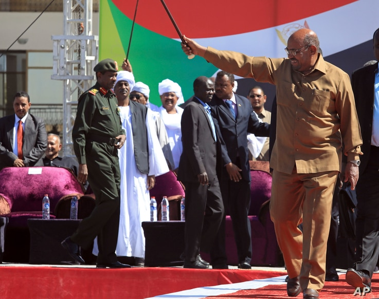 Sudan's President Omar al-Bashir greets his supporters at a rally in Khartoum, Sudan, Wednesday, Jan. 9, 2019.
