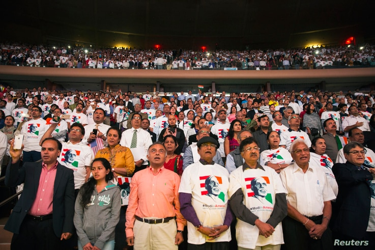 Attendees stand as India's Prime Minister Narendra Modi arrives to speak at Madison Square Garden in New York Sept. 28, 2014.