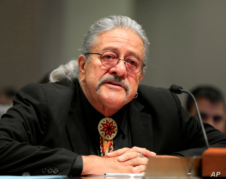 Former Oglala Tribal President Bryan Brewer testifies in Lincoln, Neb., Tuesday, Oct. 11, 2016, at a hearing convened to look for ways to reduce alcohol-related problems in Whiteclay, Neb. Activists and Nebraska lawmakers were once again at odds over...