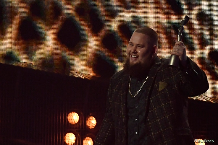 Rory Graham, lead singer of British band Rag 'n' Bone, accepts the award for British breakthrough at the Brit Awards at the O2 Arena in London, Feb. 22, 2017.