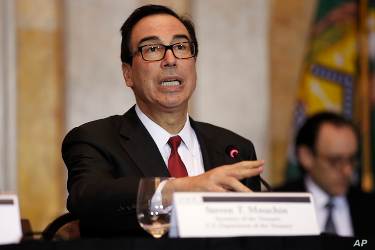 Treasury Secretary Steven Mnuchin speaks during a meeting of the Financial Stability Oversight Council, Oct. 16, 2018, at the Treasury Department in Washington.