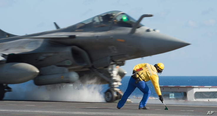 Photo, released Nov. 23, 2015 by the French Army Communications Audiovisual office (ECPAD), shows a French army Rafale fighter jet taking off from the deck of France's aircraft carrier Charles De Gaulle, in the Mediterranean sea.