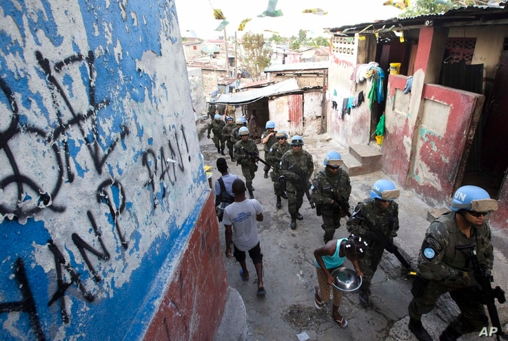 U.N. peacekeepers from Brazil patrol the Cite Soleil slum in Port-au-Prince, Haiti, Feb. 22, 2017. They faced no greater threat than a few barking dogs along some of the same streets where pitched gun battles between gangs and U.N. peacekeepers used...