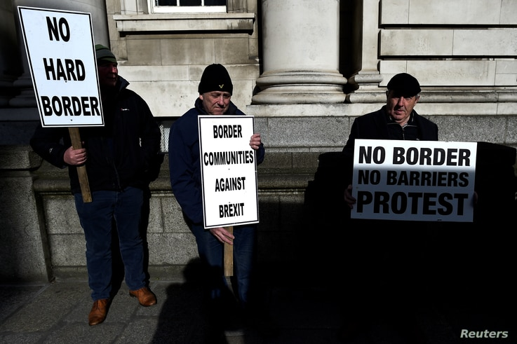 FILE - Anti-Brexit campaigners Borders Against Brexit protest outside Irish government buildings in Dublin, Ireland, April 25, 2017.