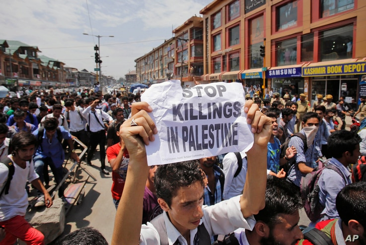 Kashmiri protesters shout slogans against Israel as they participate in a protest rally in Srinagar, India, Monday, July 14, 2014. The protest was against the Israeli military operation in Gaza strip. Palestinian militants in the Gaza Strip launched