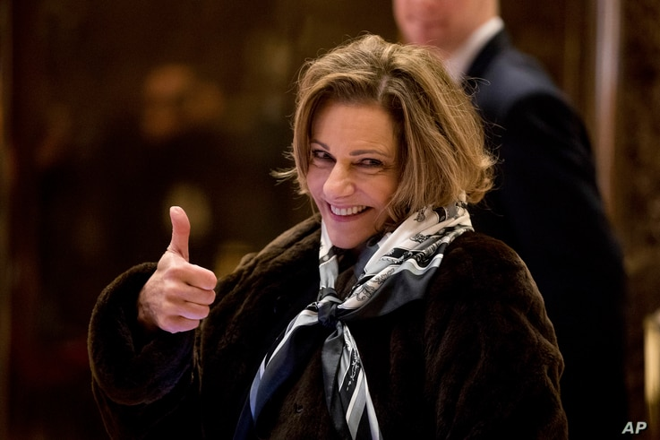 FILE - K.T. McFarland, deputy national security adviser for President-elect Donald Trump, give a thumbs up to members of the media as she arrives at Trump Tower in New York, Jan. 3, 2017.