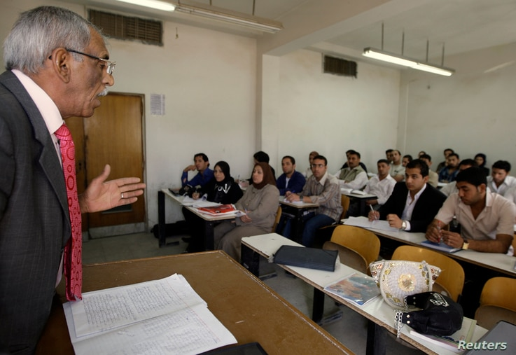 FILE - A professor gives a lecture to students at the College of Administration and Economy in Baghdad University, March 16, 2009.