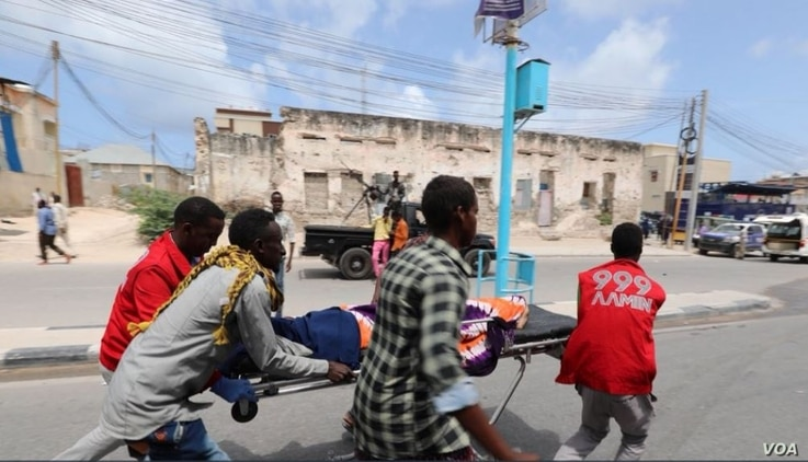 An Aimin Ambulance team transports a body after a bombing at the Somali interior ministry compound in Mogadishu, July 9, 2018.