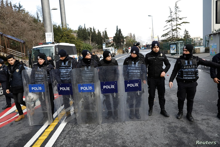 Turkish police stand guard on a road leading to the Reina nightclub by the Bosphorus, which was attacked by a gunman, in Istanbul, Jan. 1, 2017.