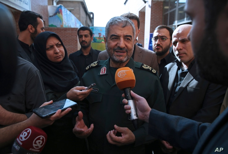 """The head of Iran's paramilitary Revolutionary Guard Gen. Mohammad Ali Jafari speaks with journalists after he addressed a conference called """"A World Without Terror,"""" in Tehran, Iran, Oct. 31, 2017."""