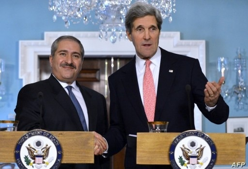 US Secretary of State John Kerry shakes hands with Jordanian Foreign Minister Nasser Judeh (L) at State Department Feb. 13, 2013
