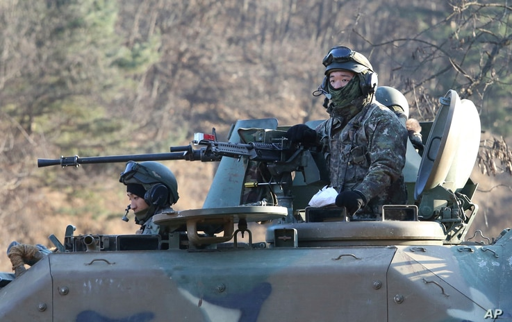 South Korean army soldiers ride an armored vehicle during an annual exercise in Paju, near the border with North Korea, South Korea, Dec. 2, 2016.