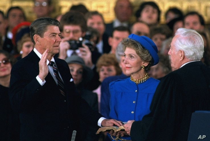 First Lady Nancy Reagan looks on as President Ronald Reagan is sworn in on Monday, January 21, 1985.
