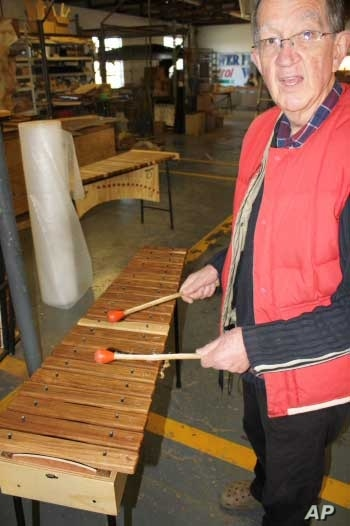 Andrew Tracey with a xylophone inside the AMI factory in South Africa, one of the few remaining manufacturers of traditional African instruments