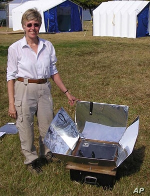 Patricia McArdle with a solar cooker, similar to the one she introduced to Afghan villagers.