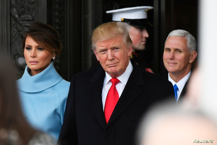 President Donald Trump and Melania Trump depart the 2017 Presidential Inauguration at the U.S. Capitol, Jan. 20, 2017. Vice President Mike Pence is at right.