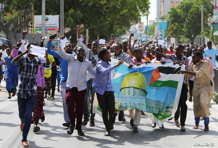 Somalis attend a protest against U.S. President Donald Trump's decision to recognize Jerusalem as the capital of Israel, in Mogadishu, Somalia, Dec. 8, 2017.