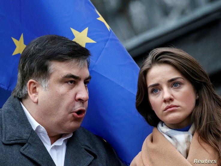 FILE - Former Georgian President and former governor of Odessa region Mikheil Saakashvili, left, and Yulia Marushevska, former head of the customs office at the Black Sea port of Odessa, attend an anti-government rally in central Kyiv, Ukraine, Nov. ...
