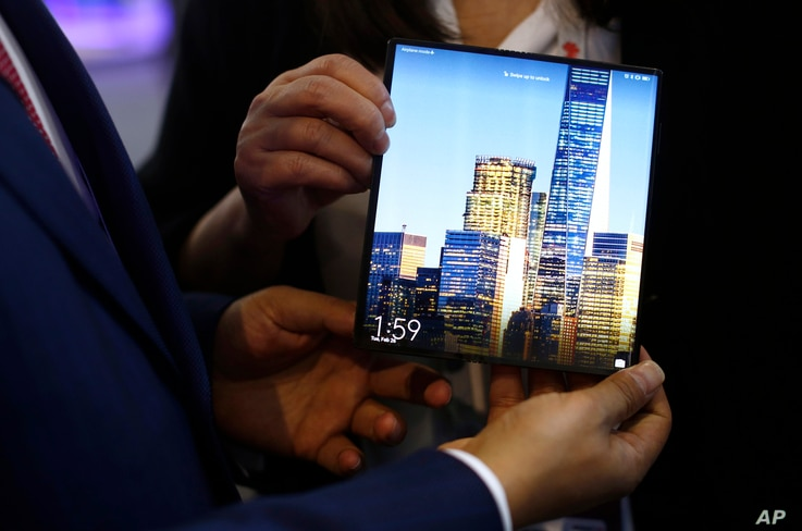 A man holds the new Huawei Mate X foldable 5G smartphone during the Mobile World Congress wireless show, in Barcelona, Spain, Feb. 26, 2019.