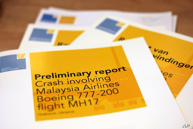 A stack of preliminary reports by the Dutch Safety Board on the crash of Malaysia Airlines flight MH17 is displayed at the board's headquarters in The Hague, Netherlands, Sept. 9, 2014.
