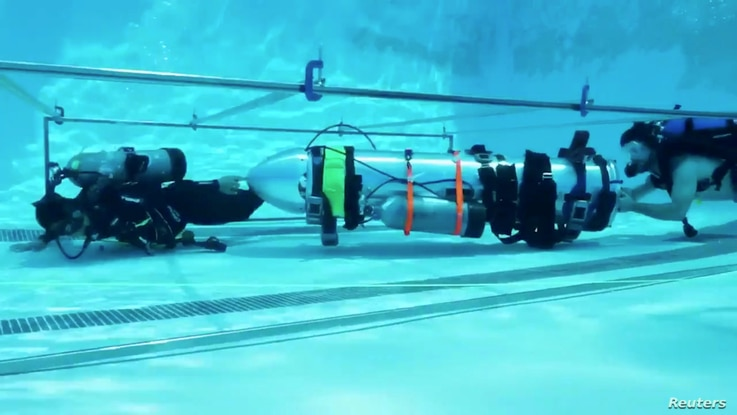 FILE - A device by Elon Musk's SpaceX and The Boring Company, designed to help rescue the remaining members of a soccer team trapped in a flooded cave in Chiang Rai, Thailand, is being tested in a swimming pool in Los Angeles, California, in this sti...