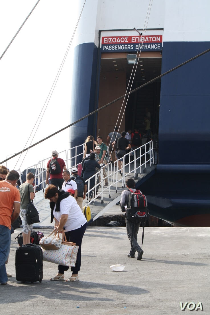 Most on this boat holding thousands of people are fleeing wars or extreme poverty related to war. But regular tourists were also aboard, Sept. 12, 2015. (Credit: Heather Murdock/VOA)