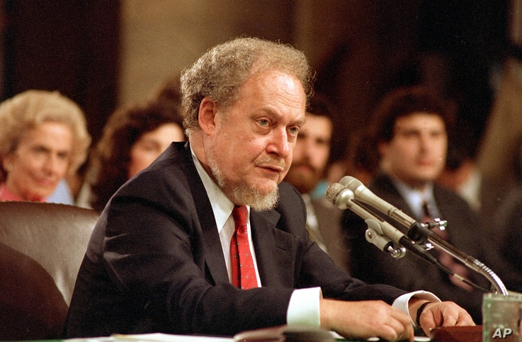 FILE - U.S. Supreme Court nominee Robert H. Bork testifies before the Senate Judiciary Committee during his confirmation hearings on Capitol Hill, Sept. 16, 1987.