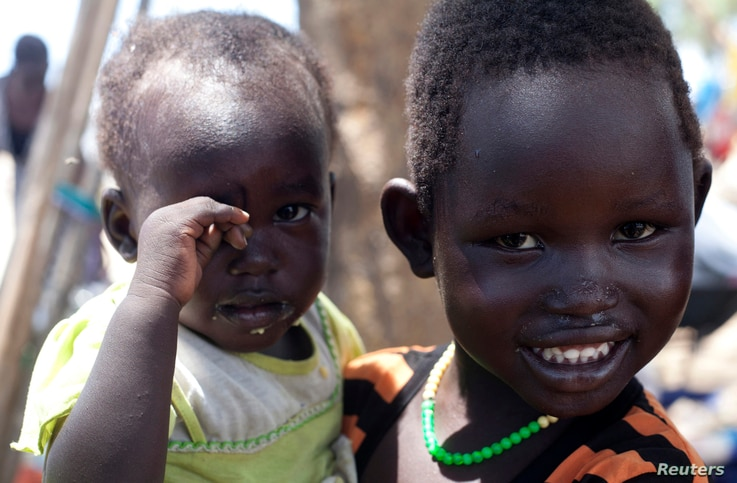 South Sudanese children displaced by fighting pose for a photo at a refugee camp in Jonglei, the country's largest state, on April 29, 2014.