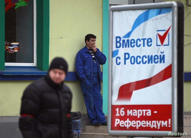 A poster calling for people to vote in the upcoming referendum is seen in Simferopol March 11, 2014. Ukraine's interim leaders established a new National Guard on Tuesday and appealed to the United States and Britain for assistance against what they ...