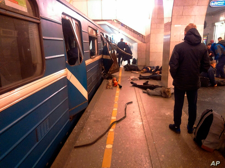 Blast victims lie near a subway train hit by a explosion at the Tekhnologichesky Institut subway station in St.Petersburg, Russia, April 3, 2017.
