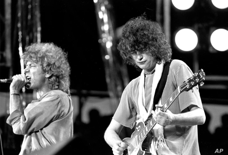 FILE - Singer Robert Plant, left, and guitarist Jimmy Page of the British rock band Led Zeppelin perform at the Live Aid concert at Philadelphia's J.F.K. Stadium, July 13, 1985.