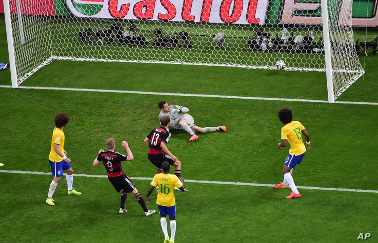 Germany's Andre Schuerrle scores his side's 6th goal during the World Cup semifinal soccer match between Brazil and Germany at the Mineirao Stadium in Belo Horizonte, Brazil, July 8, 2014.