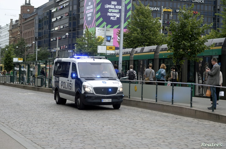 Finnish police patrol the streets in central Helsinki, Finland, Aug. 18, 2017, after stabbings in Turku.