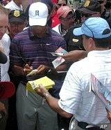 Tiger signing autographs at this year's AT&T Tournament