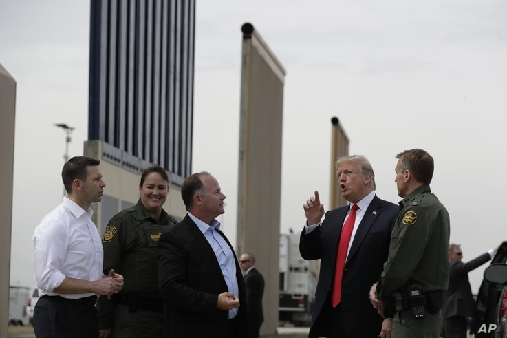 President Donald Trump reviews border wall prototypes, March 13, 2018, in San Diego.