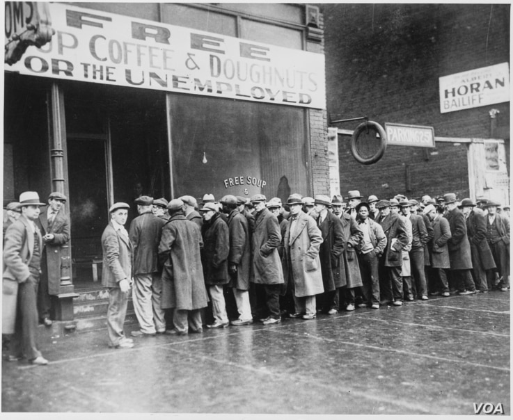 Unemployed men queued outside a depression soup kitchen opened in Chicago by Al Capone, Feburary 1931