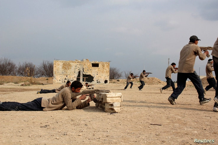 New recruits attend military training to be part of the Free Syrian Army in eastern al-Ghouta, near Damascus, Feb. 16, 2014.