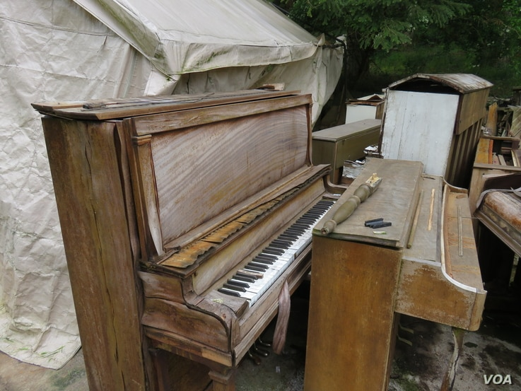 Some of Dean Petrich's collection of pianos were ruined this past winter when a storm ripped apart a storage tent and exposed the instruments to rain.