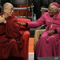 A 2008 file photo shows the Dalai Lama (L) with Archbishop Desmond Tutu of South Africa at the University of Washington in Seattle.