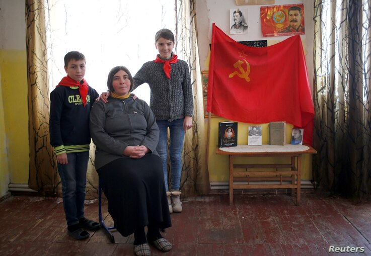 Natia Babunashvili, 40, an unemployed mother of two, poses for a portrait with her children Tamuna (R), 14, and Giorgi, 13, at her home in Tbilisi, Georgia, Nov. 24, 2016.