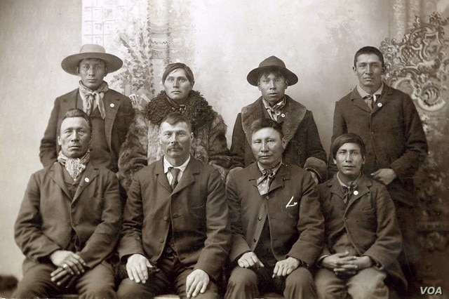 Paul Holytrack (top row, second from right) and Phillip Ireland (bottom row, far right), suspects in the February 1897 murder of a white settler family in Emmons County, N.D. Holytrack, Ireland and Alex Cadotte (not pictured) were lynched by townspeo...